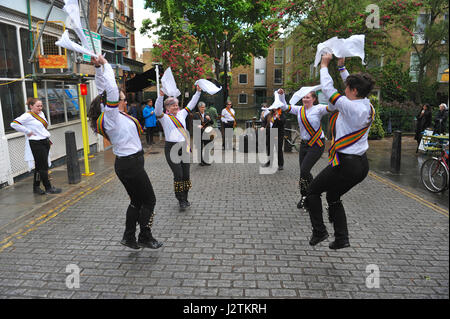 Islington, London, UK. 1st May,  2017. On a slightly damp day, New Esperance Morris dance outside The Camden Head - Stock Photo