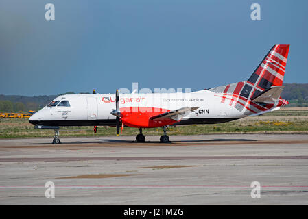 Inverness airport, Scotland, UK. 1st of May, 2017. Arrival of the new Loganair Saab 340B in its new tartan livery - Stock Photo