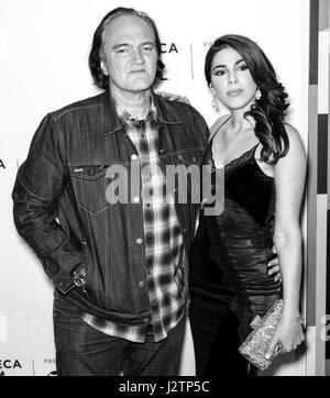 NEW YORK, NY - APRIL 28, 2017: Director Quentin Tarantino and Daniella Pick attend the 'Reservoir Dogs' 25th Anniversary - Stock Photo