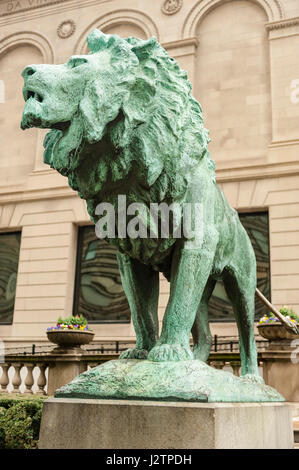 Art Institute of Chicago museum, north lion bronze statue, on the prowl, by Edward Kemeys, entrance of the museum, - Stock Photo