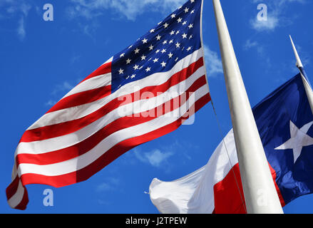 The American flag flying in front of the Dallas City Hall in Texas. - Stock Photo