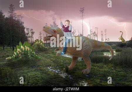 Fantasy a little boy riding on a dinosaur - Stock Photo