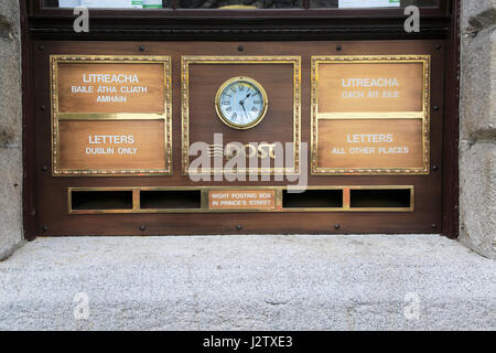 Letter  boxes and clock outside the General Post Office, O' Connell Street, Dublin city centre, Ireland, Republic - Stock Photo