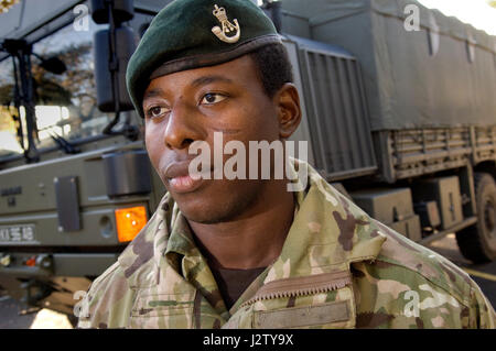 Rifleman Paul Apowida, former African 'Spirit Child' who was helped by Afrikids at the The Rifles Medal Parade at - Stock Photo