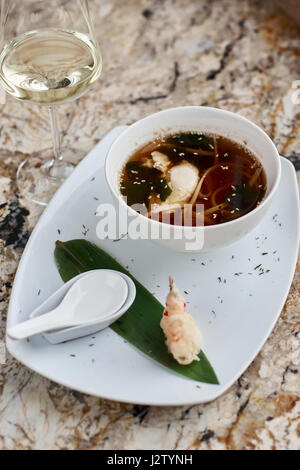 Japanese noodle soup udon in bowl - Stock Photo