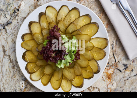 marinated cucumber slices on plate - Stock Photo