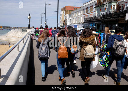 young foreign tourists on a visit to the coastal town of margate in kent uk april 2017 - Stock Photo