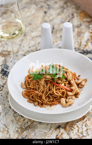 Thin noodles with chicken slices - Stock Photo