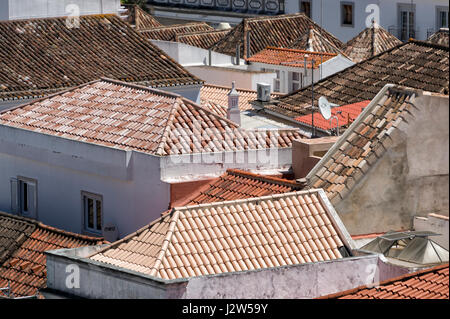 terracotta tiled rooftops of the old town of Tavira in the eastern Algarve of Portugal - Stock Photo