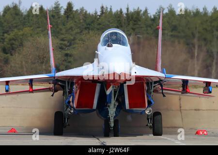 KUBINKA, MOSCOW REGION, RUSSIA - APRIL 21, 2017: Mikoyan-Gurevich MiG-29 of Swifts aerobatics team of Russian air - Stock Photo