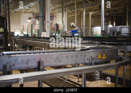 Beer production line. Equipment for the staged production and bottling of the finished product. Special industrial technological device at the factory