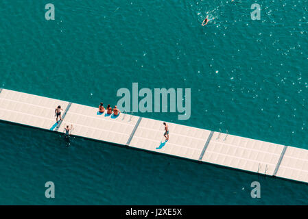 Unrecognizable people enjoying hot summer afternoon on lake Bled, aerial view of leisure and recreational activity - Stock Photo