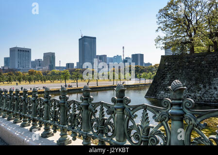 Looking across the outer gardens, from the Imperial Palace, bronze railins in the foreground. - Stock Photo