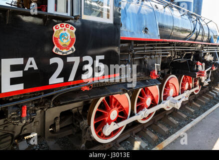Samara, Russia - Apri 29, 2017: Russian retro steam locomotive with symbol of former state the USSR and red wheels - Stock Photo
