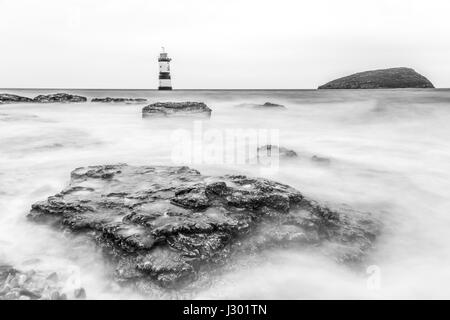 Trwyn Du or Penmon Lighthouse between Dinmor Point near Penmon and Ynys Seriol, or Puffin Island, at the eastern - Stock Photo