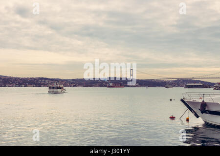 View of Bosphorus and Fatih Sultan Mehmet bridge. Ferry approaching the second bridge at the Bosphorus in Istanbul, - Stock Photo