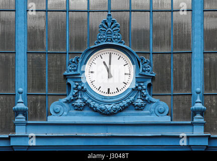 Eleven hours show the train station clock. - Stock Photo