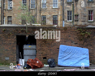 Glasgow park district Fly tipping rubbish garbage rat infested discarded mattress - Stock Photo