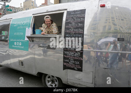 A Vendor Selling Food Out Of Chrome Trailer At The Eighth Avenue Street Fair In