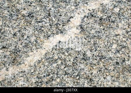 Quartz vein in granite rock - Stock Photo