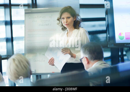 Business presentation by female coworker - Stock Photo