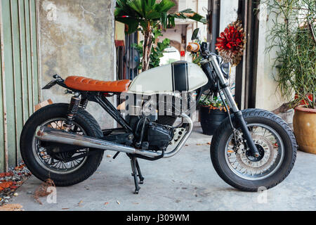 GEORGE TOWN, MALAYSIA - MARCH 27: Vintage motorcycle parked on the street of Penang on March 27, 2016 in George - Stock Photo