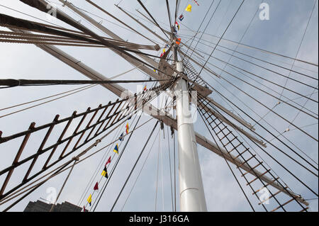 One of the masts and some of the rigging on the Wavertree, a recently restored 1885 cargo ship belonging to the - Stock Photo