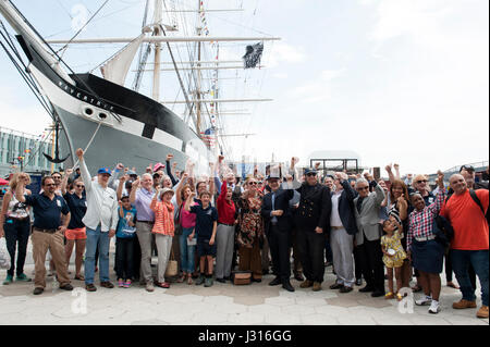 On April 29, 2017, the South Street Seaport Museum celebrated its 50th anniversary. Behind some of the celebrants - Stock Photo