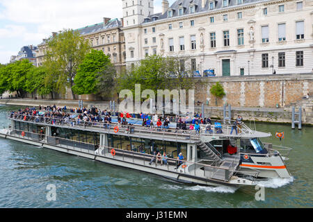 Tourists on a river boat cruise on the River Seine, Paris, france - Stock Photo
