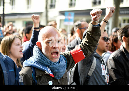Paris, France. 1st May, 2017. People shout slogans during an annual march for International Labor Day in Paris, capital of France, on May 1, 2017. Credit: Chen Yichen/Xinhua/Alamy Live News Stock Photo