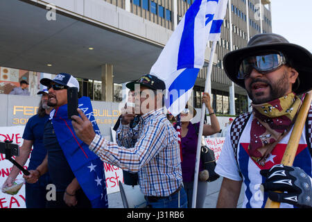 Los Angeles, USA. 1st May, 2017. Dozens of sympathizers of US President Donald Trump show support for his anti-immigration - Stock Photo