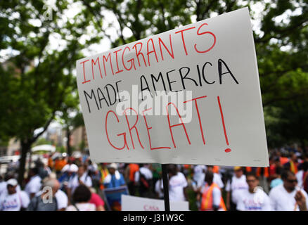 Washington, USA. 1st May, 2017. People attend Immigrants and Workers March protesting against immigration policies - Stock Photo