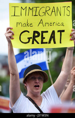Washington, USA. 1st May, 2017. A woman attends Immigrants and Workers March protesting against immigration policies - Stock Photo