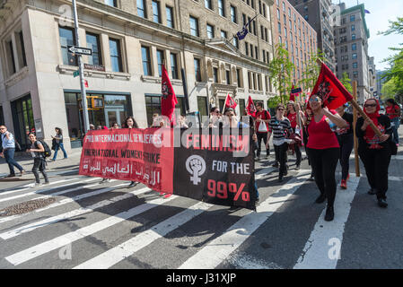 New York, USA. 01st May, 2017. New York, NY 1 May 2017 - Socialists, dressed in red, march up University Place, - Stock Photo