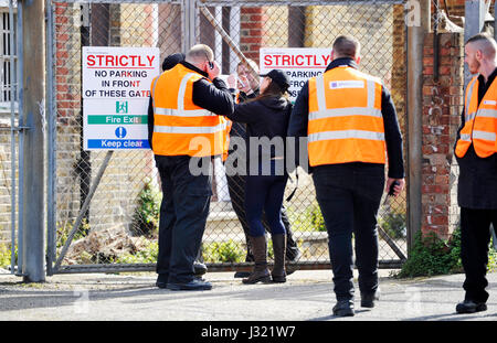 Brighton, UK. 2nd May, 2017. Security staff try to secure the building after squatters were evicted from the University - Stock Photo
