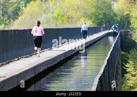 People crossing over the Unesco World Heritage Site of Pontcysyllte Aqueduct on the Llangollen Canal that crosses - Stock Photo