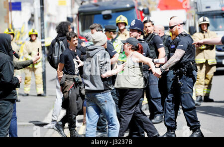 Brighton, UK. 2nd May, 2017. Police squatters and security staff stand off at the University of Brighton Circus - Stock Photo