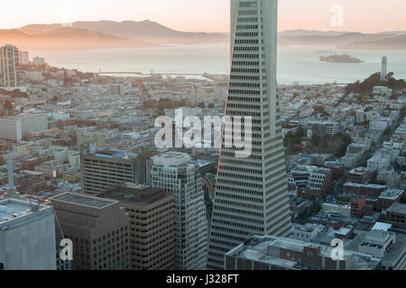 Sunset over Telegraph Hill, Alcatraz Island and San Francisco Bay from the Financial District. - Stock Photo