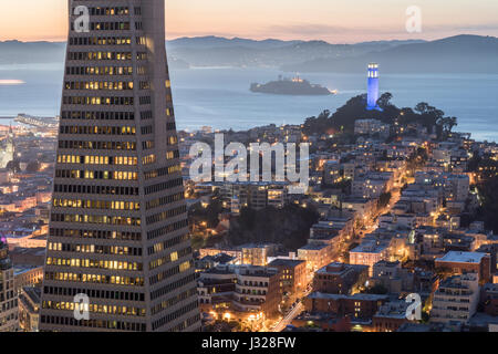 Dusk over Telegraph Hill, Alcatraz Island and San Francisco Bay from the Financial District. - Stock Photo