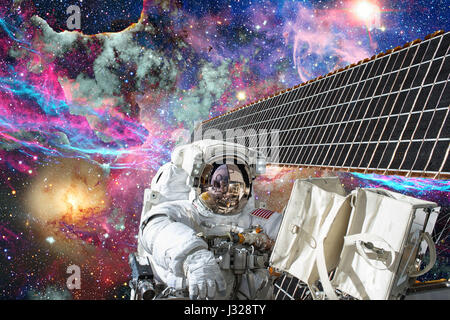 International Space Station and astronaut in outer space over the planet Earth.