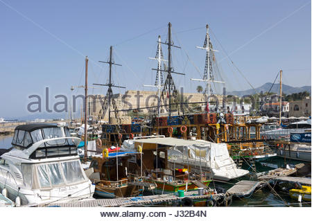 Yachts, tall ships and pleasure craft in the harbour at Kyrenia, northern Cyprus with the castle in the background - Stock Photo