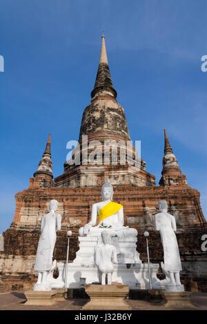 Old pagoda and buddha image in Wat Yai Chaimongkol temple, Ayutthaya Thailand - Stock Photo