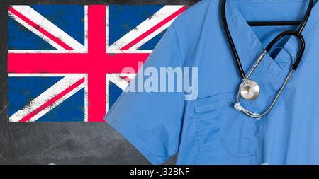 Doctors scrubs and stethoscope in front of Union Jack flag. NHS healthcare UK, medical concept - Stock Photo