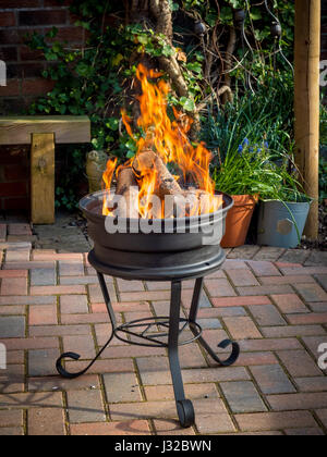 flames by a car fire upcycled car wheels turned into wood burning firebowl stock photo