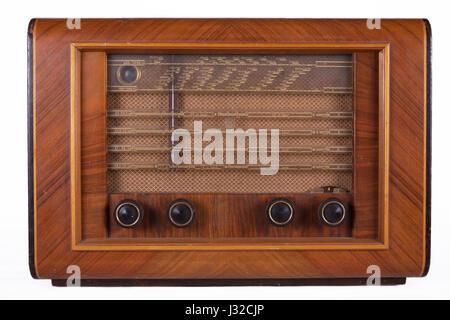 Old retro table tube radio isolated on white background - Stock Photo