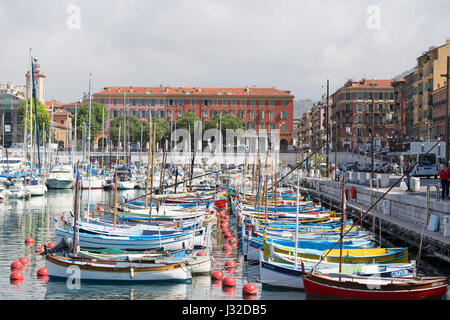 France, Nice, colourful old wooden fishing boats in the harbour. - Stock Photo