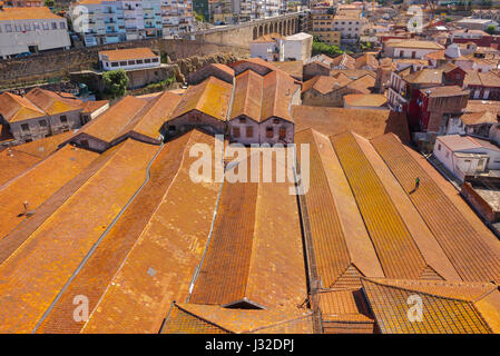 Porto wine lodge, an aerial view of the roofs of port wine lodges lining the waterfront in the Vila Nova de Gaia - Stock Photo