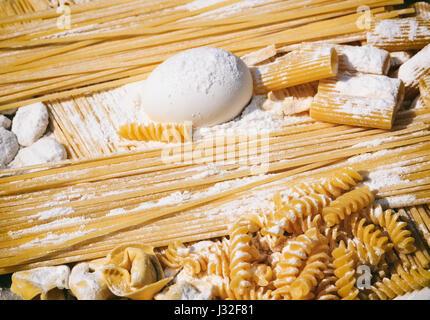 Raw Italian pasta and ingredients - pasta preparation - Stock Photo