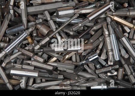 Macro of old rusty used screwdriver bits in a box - Stock Photo
