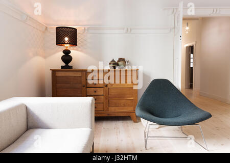 Side board buffet chair and lamp in a luxury apartment renovation in Australia - Stock Photo
